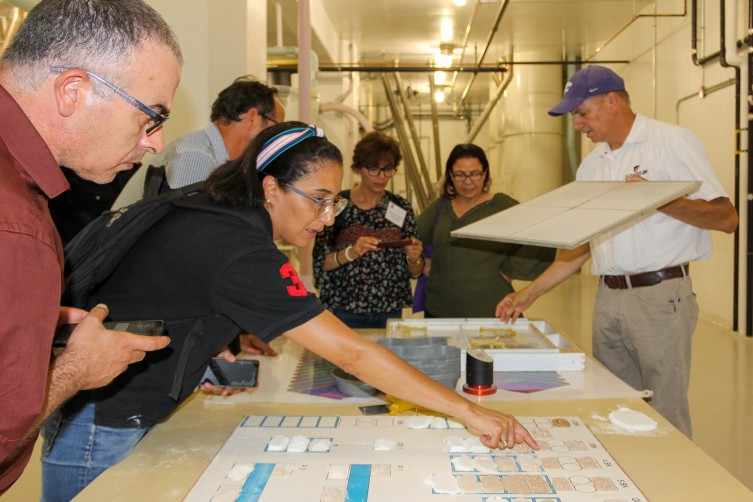 Participants of the USDA Cochran Tunisia Market Reform within the Wheat Value Chain look at the various wheat consistencies while touring Kansas State University's Hal Ross Flour Mill.