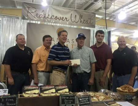 Darwin Ediger receives the Wheat Quality Initiative Award from Governor Sam Brownback at the Kansas State Fair.