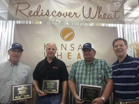 Yield Contest winners Darwin Ediger, Darren Nelson and Doug Queen with Governor Brownback.