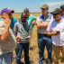 Kansas wheat farmer, Joe Kejr, explains to participants the process of harvesting wheat and how the recent rain has affected the harvest.