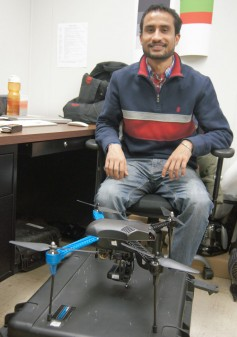 Photo of Singh and the sUAS: Daljit Singh, K-State doctoral student in plant pathology, is studying how small unmanned aerial systems, or drones, can help wheat researchers identify higher yielding, more heat and drought tolerant wheat lines faster.