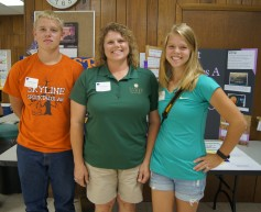Anita DeWeese (center) and her now-teenage children – Jarod (left) and Jessica (right) – have attended the Kansas 4-H Wheat Expo for nearly 10 years.