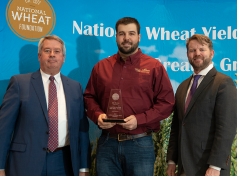 Alec Horton receives award in the National Wheat Yield Contest.