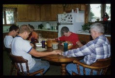 Photo: Keeslings around dinner table, 1998, Credit:  Kansas State Historical Society.