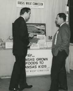 Bob Dole visiting the Kansas Wheat Commission booth at the Kansas State Fair. Photo courtesy of the Robert J.Dole Institute of Politics.