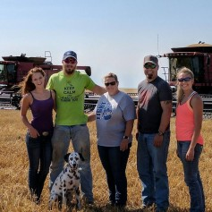 Cassidy Kreigh poses with the Schemm family during 2017 wheat harvest.