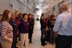 Spokespersons learn about wheat research during a tour of the Kansas Wheat Innovation Center.